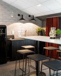 Modernt kök med barbord hos Abri